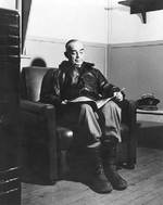 Kinkaid reading in his quarters on Adak, Aleutian Islands, 14 May 1943
