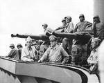 Vice Admiral Thomas Kinkaid, General Douglas MacArthur, and Colonel Lloyd Labrbas aboard cruiser Phoenix during bombardment of Los Negros Island, 28 Feb 1944; note 40-mm gun mount in background