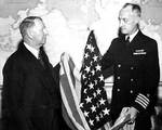 Capt James Doyle presented Knox the first US flag over Japanese territory (Kwajalein), 29 Feb 1944