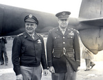 US Army Lieutenant General James Doolittle and Major General Curtis LeMay at 8th Air Force headquarters, High Wycombe, England, United Kingdom, 1945; note a tail boom of a P-38 Lightning behind them