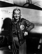 Nancy Harkness Love posing in front of a PT-19A trainer aircraft, 1942-43. Note WAFS patch on her jacket (forerunner of the WASPs).