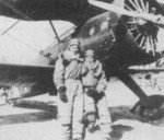 Chinese pilots Jiang Xianxiang (left) and Luo Yingde (right) with a Hawk II (F11C Goshawk) fighter, China, 1930s