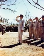 MacArthur saluted as the US National Anthem was played, Philippines, 1 Aug 1945