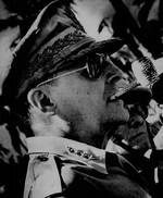 Profile of MacArthur shortly after fulfilling his promise to return, Tacloban, Leyte, Philippines, 23 Oct 1944. Note Sergio Osmeña behind MacArthur.