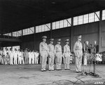 Douglas MacArthur at the induction ceremony of Philippine Army Air Corps, Zablan Field, Camp Murphy, Rizal, Philippine Islands, 15 Aug 1941; behind MacArthur, left to right: Richard Sutherland, Harold George, William Marquat, LeGrande Diller
