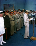 General Douglas MacArthur speaking aboard USS Missouri, Tokyo Bay, Japan, 2 Sep 1945, 2 of 4