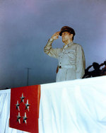 MacArthur saluted as he reviewed the American Independence Day parade at the Emperor