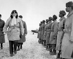 General of the Army Douglas MacArthur inspecting troops of the 24th Infantry Division at Gimpo airfield near Seoul, Korea, 21 Feb 1951