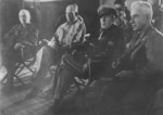 General Edward Almond, General Lemuel Shepherd, General Douglas MacArthur, General Oliver Smith, and Colonel McAllister at a division command post southeast of Inchon, Korea, 17 Sep 1950