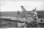 Hans-Joachim Marseille with a British Hurricane fighter that he had shot down, Libya, Mar 1942, photo 2 of 3