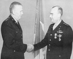 General George Marshall congratulates Lieutenant General Joseph McNarney after presenting him with the Distingushed Service Medal and the Legion of Merit, 1944