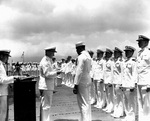 Doris Miller receiving the Navy Cross award from Admiral Chester Nimitz, onboard carrier Enterprise, Pearl Harbor, US Territory of Hawaii, 27 May 1942; photo 1 of 2