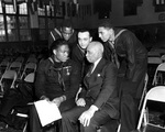 US Navy Mess Attendant First Class Doris Miller talking with three sailors and a civilian, during his war bond tour stop at the Naval Training Station, Great Lakes, Illinois, United States, 7 Jan 1943