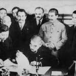 Japanese Foreign Minister Matsuoka signing the Soviet-Japanese Neutrality Pact, 13 Apr 1941, photo 3 of 3; note Molotov and Stalin in background
