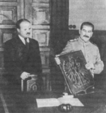 Joseph Stalin presenting the coat of arms of Poland with Vyacheslav Molotov at his side, early Nov 1944