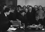 Japanese Foreign Minister Matsuoka signing the Soviet-Japanese Neutrality Pact, 13 Apr 1941, photo 2 of 3; note Molotov and Stalin in background