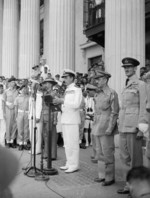 Supreme Allied Commander South East Asia Admiral Lord Louis Mountbatten delivering an address at the Municipal Building, Singapore, 12 Sep 1945, photo 1 of 2; note William Slim, Raymond Wheeler, and Keith Park