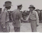 Admiral Louis Mountbatten shaking hands RAAF Warrant Officer T. Hughes of No. 2 Squadron RAAF, Balikpapan, Borneo, 10 Dec 1945