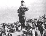 Benito Mussolini giving a speech atop a L3/35 tankette, date unknown