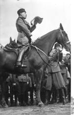 Benito Mussolini atop a horse in the Dolomites mountains in northeastern Italy, Aug 1929