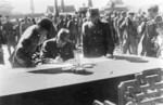Hiroshi Nemoto signing the surrender document at the Forbidden City, Beiping, China, 10 Oct 1945, photo 1 of 3
