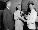 Rear Admiral Chester Nimitz being sworn in as US Navy Chief of the Bureau of Navigation by Rear Admiral Walter Woodson at the Navy Department, Washington DC, United States, Jun 1939
