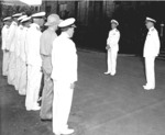 Admiral Nimitz addressing officers immediately after assuming command of Pacific Fleet, Pearl Harbor, US Territory of Hawaii, 31 Dec 1941; Admiral Kimmel at right