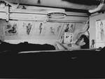 American sailor reading in his bunk aboard USS Capelin, Aug 1943