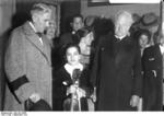 Chancellor of Germany Papen and poet Gerhart Hauptmann with 11-year-old violinist Ruggiero Ricci after she had just performed in a concert in Berlin, Germany, Sep 1932