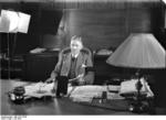 German Chancellor Papen in his office in Berlin, Germany, making a speech to an American audience over radio, Jul 1932