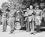 Major General Floyd Parks, John McCloyd, US Secretary of War Henry Stimson, and General George Patton during the review of US 2nd Armored Division, Berlin, Germany, 20 Jul 1945