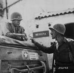 George Patton and Lieutenant Colonel Lyle Bernard, CO, 30th Infantry Regiment discussing strategy near Brolo, Sicily, Italy, circa Jul-Aug 1943