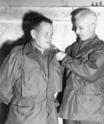 Lewis Puller being promoted to the rank of brigadier general by General Oliver Smith, 26 Jan 1951