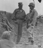 US Marine Colonel Chesty Puller (left) speaks with Assistant Division Commander Brigadier General Edward Craig overlooking Seoul, South Korea, 25 Sep 1950, photo 2 of 2