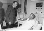 Adolf Hitler visiting the injured Karl-Jesco von Puttkamer in a hospital, late Jul 1944