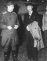 Puyi being escorted by a Soviet officer, Tokyo, Japan, 9 Aug 1946