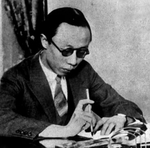 Puyi writing at a desk, circa 1920s