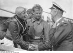 German Colonel Manhnke shaking hands with Hanna Reitsch, the only female competitor at the glider competition in the Rh?n mountains region of Germany, 27 Aug 1936