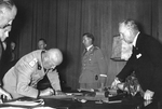 Benito Mussolini signing the Munich Agreement, Germany, 30 Sep 1938, photo 1 of 2