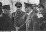 Philippe Pétain and Adolf Hitler, Montoire-sur-le-Loir, France, 24 Oct 1940; note Paul Schmidt and Joachim von Ribbentrop in background