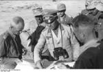 Colonel General Erwin Rommel and Major General Georg von Bismarck of 21. Panzerdivision studying a map in the field, North Africa, early summer 1942, photo 2 of 2