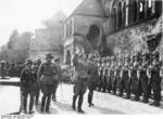 Adolf Hitler welcomed by a honor guard at Goslar, Germany, 30 Sep 1934; note Captain Erwin Rommel in background