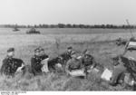 German Major General Rommel in a field in France, Jun 1940; note Panzer 38(t) tanks in the background