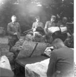 German Army Major General Erwin Rommel studying maps with officers, France, May-Jun 1940