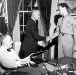USAAF B-17 Flying Fortress bomber radio operator Technical Sergeant Forrest L. Vosler receiving the Medal of Honor from US President Franklin Roosevelt, 6 Sep 1944