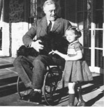 US President Roosevelt in wheel chair with dog Fala and Ruthie Bie (granddaughter of the Hyde Park caretaker), Hill Top Cottage, Hyde Park, New York, United States, Feb 1941