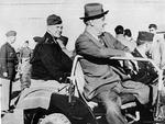 Franklin Roosevelt with Dwight Eisenhower at Castelvetrano Airport in Sicily, Italy, after the conferences at Tehran and Cairo, 8 Dec 1943; note Patton in background