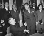 Franklin Roosevelt with USMC pilot Kenneth Walsh at the White House, Washington DC, United States, 8 Feb 1944; note Adm Ernest King, LtGen Alexander Vandegrift, Asst Secretary of Navy Ralph Bard, and Mrs Walsh