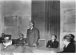 Alfred Rosenberg speaking at a press conference regarding his appointment to the eastern territories, 19 Nov 1941; also present were Gauleiter Alfred Meyer and state press chief Wilhelm Weiss