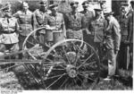 Rosenberg visiting Ukraine, inspecting agricultural equipment, Jun 1943; other men present were Gauleiter Koch, Generalkommissar Claus Selzner, and Gauleiter Helmuth